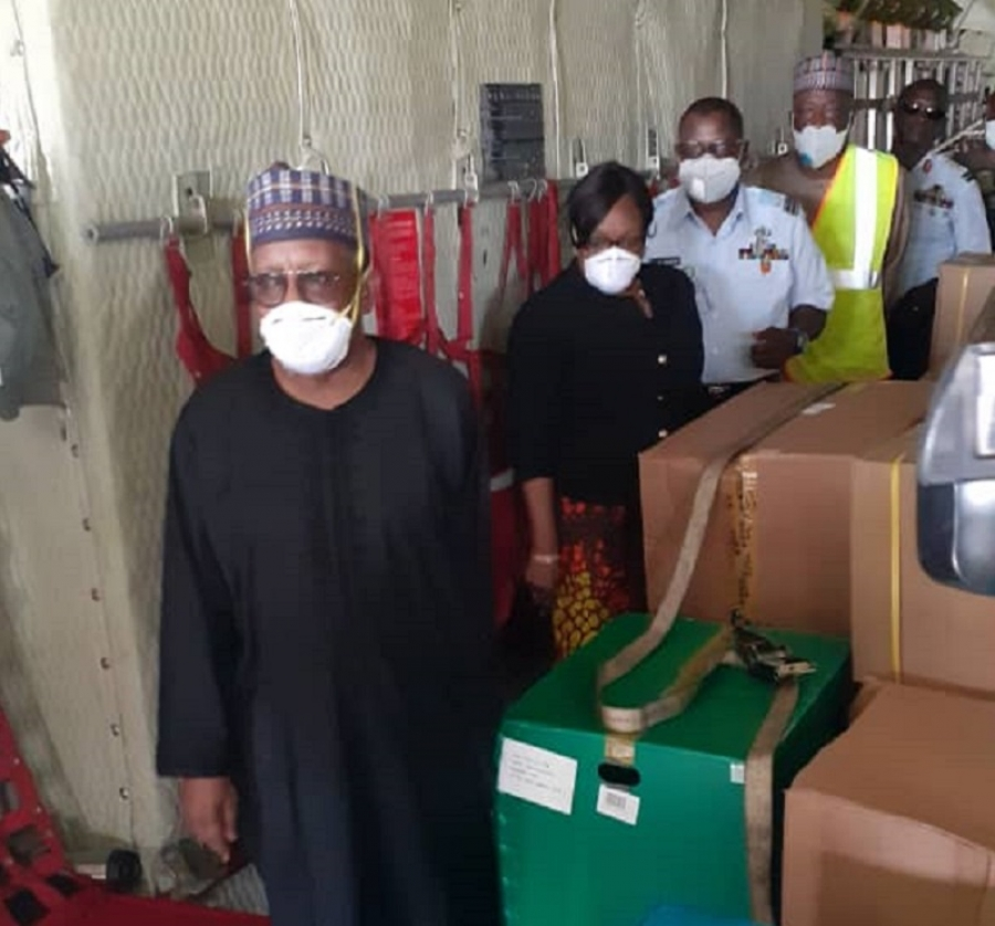 The Permanent Secretary , Health Mr Abdulaziz Abdullah receiving the consignment alongside the Director Port Health  Services, Dr Morenike Alex-Okoh